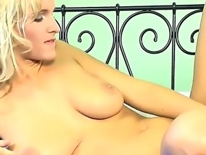 Lovely blonde Simella loves to create wild tremors down her lusty twat with...