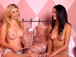 Two beautiful young hotties sitting topless and having a dirty lesbian talk