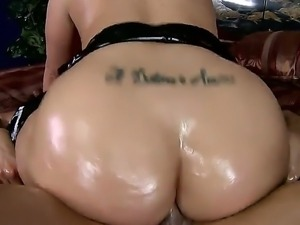Wild brunette Kelly Divine gets her giant round ass and large boobs oiled...