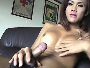 The attractive brunette she-male Rin with a small tits demonstrates in front...