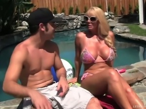 Blond MILF Karen Fisher makes no secret of her giant