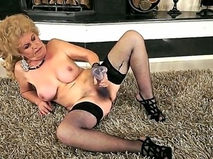 Hardcore action with a sexy granny Effie who penetrates her hairy hole with a...