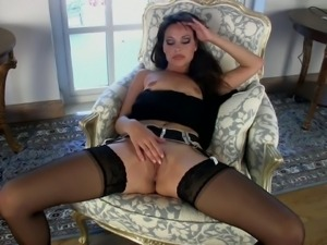 Slim brunette Lorena G dressed in black plays with her