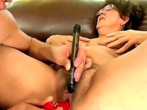 Mature slut Gigi M enjoys having her hairy cunt drilled by younger guy with...