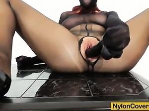 Nylon covered redhead masterbates with toys