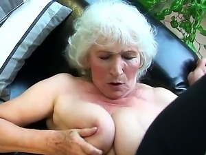 Look at hardcore scene with old whore Norma who loves titfuck