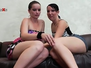 Lustful lesbians kiss and lick tits on the couch