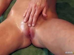 Gorgeous blonde Brynn Tyler with big breasts enjoys massage and