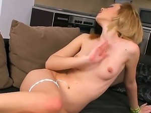 Seductive Nikita is rubbing her small perky tits and chaste shaved pussy...
