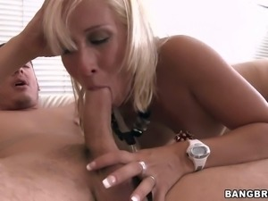 Pamela is a hot milf with blond hair and tan
