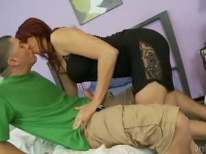 Red-haired milf Nicki Hunter gives oral pleasure to her sexy