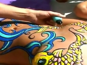 Hot lady being tatooed and pierced on her sexy stomach and then licked her...