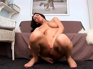 Naughty brunette babe Elena Rae spreads her legs and penetrates her pussy