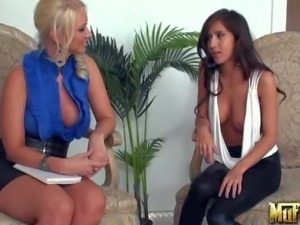Big breasted brunette April O'Neil gets interviewed by another massive