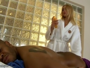 Blonde haired masseuse Teena Dolly strips naked and makes black