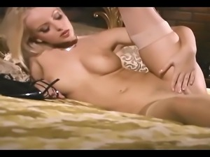 Sexy babe rubs her pussy in stockings and panties