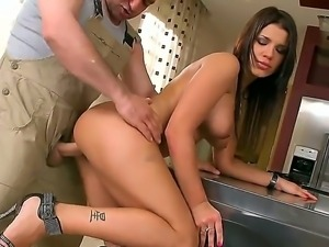 Busty and slutty brunette honey Angel Rivas enjoys in giving her handyman a...
