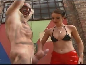 Dirty old guy gets handjob and kick in the nuts from nasty slut in red latex