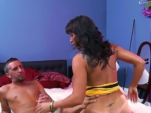 Tanned dark haired milf Lezley Zen with round fake tits in cheep yellow dress...