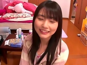 Innocent looking naive black haired japanese teen Tsubomi with natural...