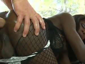 Dreamy black babe Bambi has her gorgeous tranny ass rimmed by muscular stud...