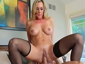 Stunning blonde milf Brandy Love with round hooters and smoking hot fit body...