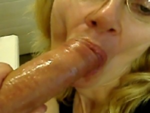 Mature blond takes a big cock all the way down her throat.