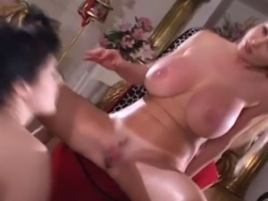 Blonde and brunette babes play with each other's pussies.
