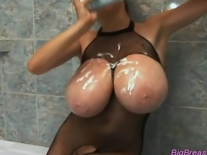 Huge breasts babe squizing her melons and teasing pussy