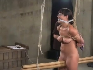 Wasteland Dungeon Master Ties Up Submissive Brunette