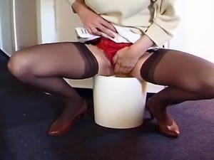 Dirty slut couldn't resist and peed in a bucket through her panty.