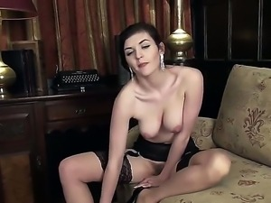 Glamour chick with cool forms of breasts and ass stays in stockings and in...