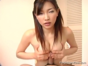 Oriental babe loves to please cock with her mouth and tits