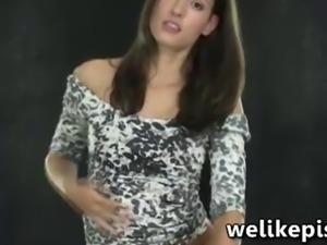 Teen Silvia Luca in erotic piss play
