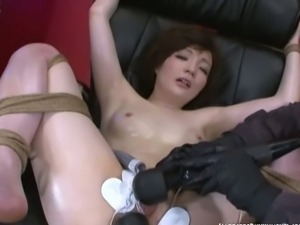Japanese slave gets her pussy toyed in bondage.