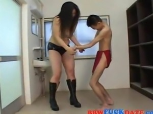 BBW Asian domina plays with a small Asian dude
