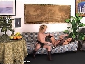 beauties inserting fists into their holes