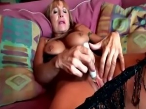 Great-looking granny pleasuring herself with a toy