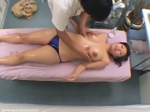 Sexy japanese brunette gets a hot massage