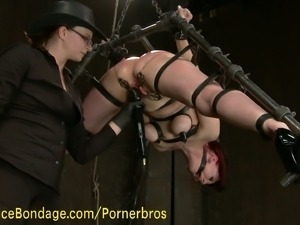 Redhead slave gets suspended and fisted
