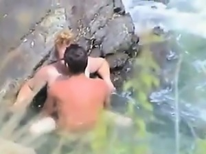 Couple Having Sex At The Sea