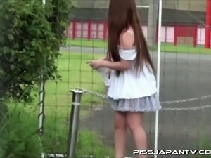 Sweet asian pissing outdoors