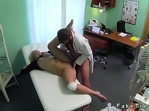 Busty blonde squirts while gets finger fucked by doctor