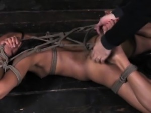 Hogtied black submissive being flagellated