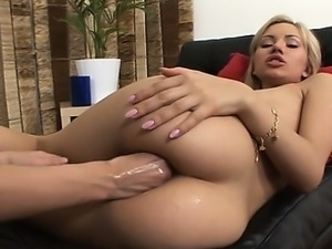This shocking blonde loves brutal anal fist