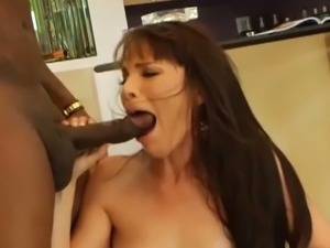 Dana stretches her ass for a black cock