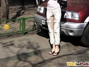 Honey pissing through pants on the street