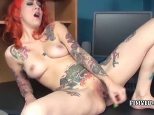 Petite and tattoo covered hottie Scarlett Storm is on the desk and fucking...