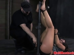Mouth gagged skank being restrained at the dungeon