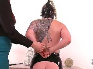 Bosomy blonde slut Angel Deelight gets herself into a leather bound, bondage...